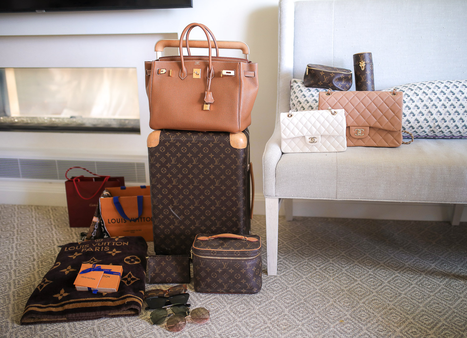 High end designer travel luggage, luxury travel style Pinterest, Louis Vuitton Horizon 55 carry on, Hermes berkin 35 tan gold hardware, montage laguna beach montage beach, riki travel mirror, Travel makeup hacks storage | Travel Hacks by popular life and style blog, The Sweetest Thing: image of Louis Vuitton luggage, Louis Vuitton storage container, Chanel handbags, designer sunglasses, and Louis Vuitton blanket.
