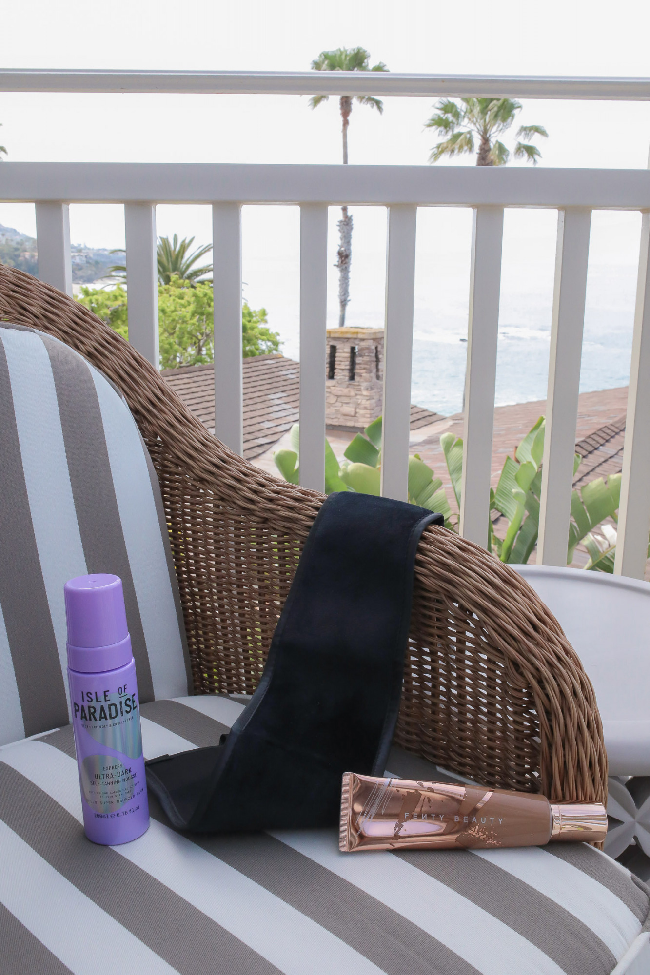 Best self tanner 2021, Isle of Paradise ultra Dark Self Tanner, Fenty self tanner makeup | Travel Hacks by popular life and style blog, The Sweetest Thing: image of Fenty Beauty self tanner, Isle of Paradise self tanner, and a self tanner towel.