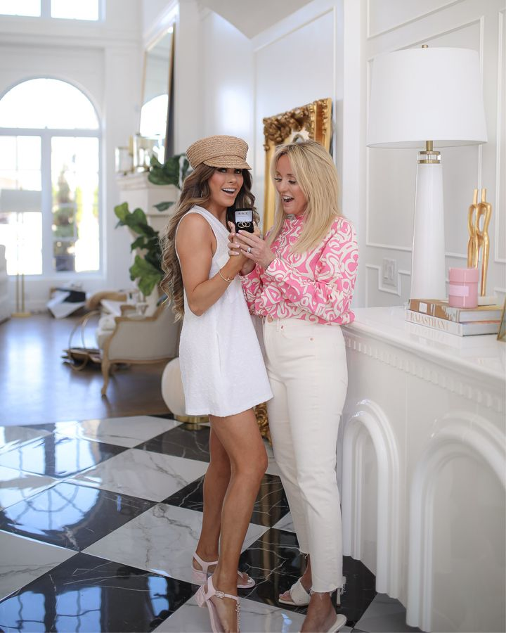 Kay Jewelers, Mother Daughter Photo, Gifts for Mom, Mother's Day Gifts, Gold Diamond Hoop Earrings, Spring Outfit, Pink Chanel Sandals   April Instagram Recap by popular US fashion blog, The Sweetest Thing: image of Emily Gemma and her mom standing together and wearing a white sleeveless dress, tan strap block heel sandals, pink and white long sleeve blouse, white jeans, straw flour boy cap, and white heel sandals.