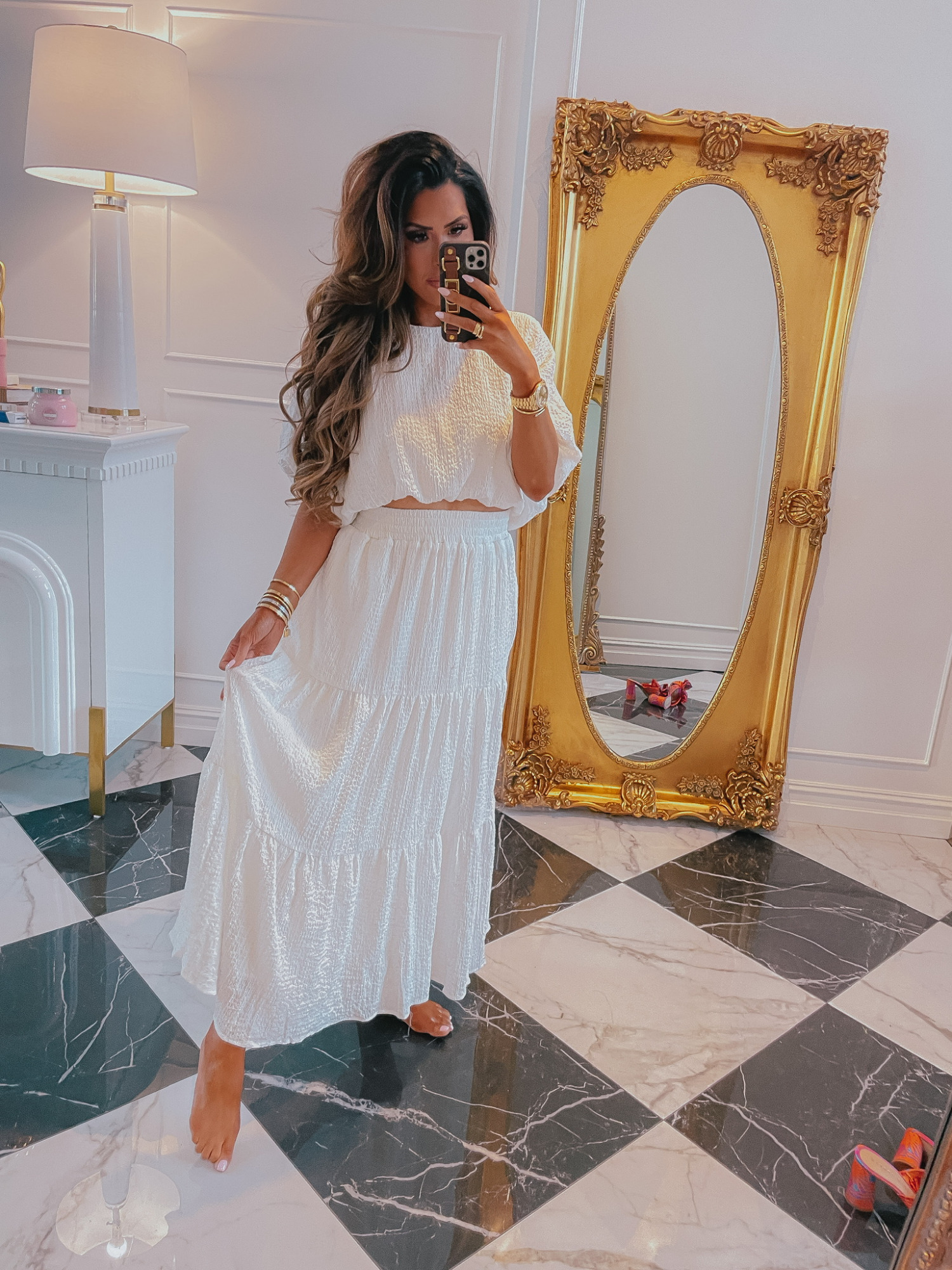 Red Dress Boutique, Try On Haul, Emily Ann Gemma, White Midi Skirt, White Midi Top, White Summer Outfit Ideas, White Top | Instagram Recap by popular US life and style blog, The Sweetest Thing: image of Emily Gemma wearing a white crop top and tiered maxi skirt and holding a smartphone in a Louis Vuitton phone case.