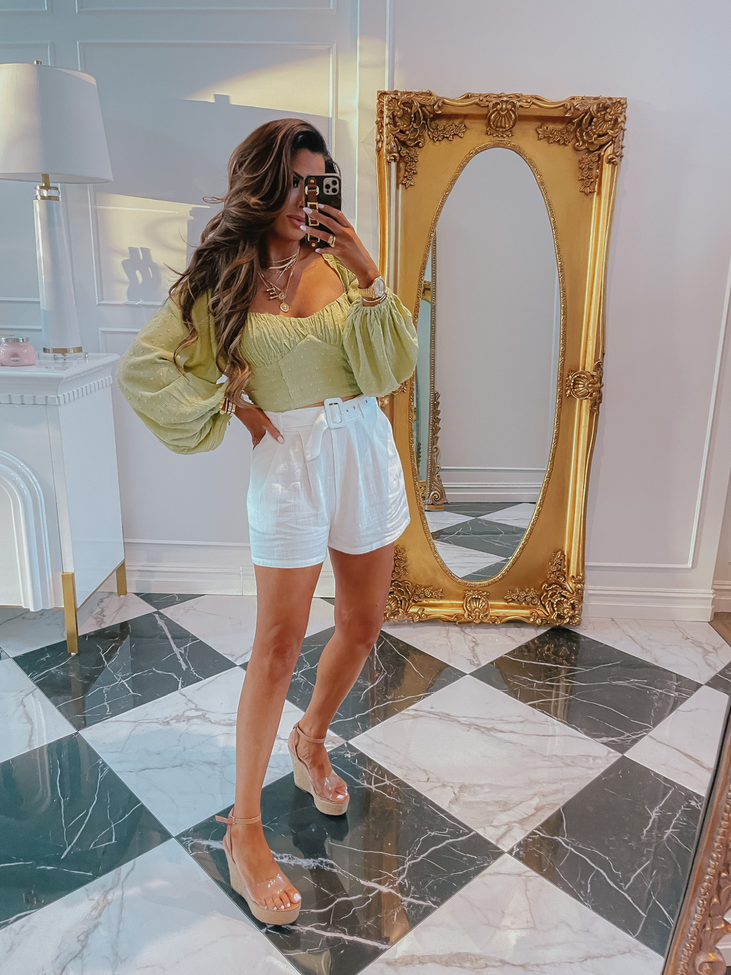 Emily-ann-gemma-forever-21-try-on-haul-ltk-day-sale-shorts-summer-outfit   LTK Sales by popular US fashion blog, The Sweetest Thing: image of Emily Gemma wearing a green puff sleeve blouse, white shorts, and brown espadrilles.