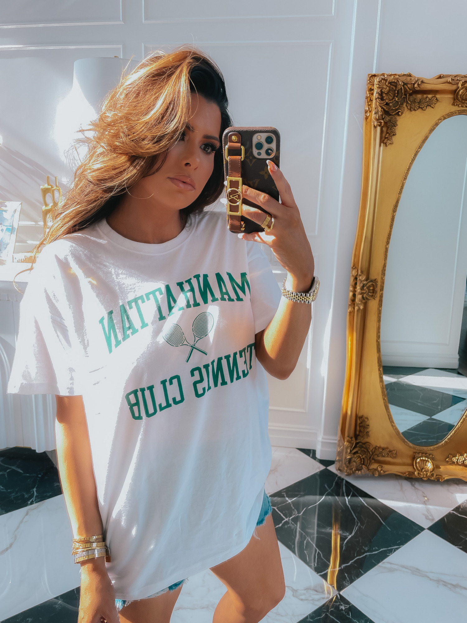 Casual-tee-shirt-abercrombie-ltk-day-sale-jean-shorts-summer-2021   LTK Sales by popular US fashion blog, The Sweetest Thing: image of Emily Gemma wearing a Manhattan Tennis Club t-shirt and jean shorts.