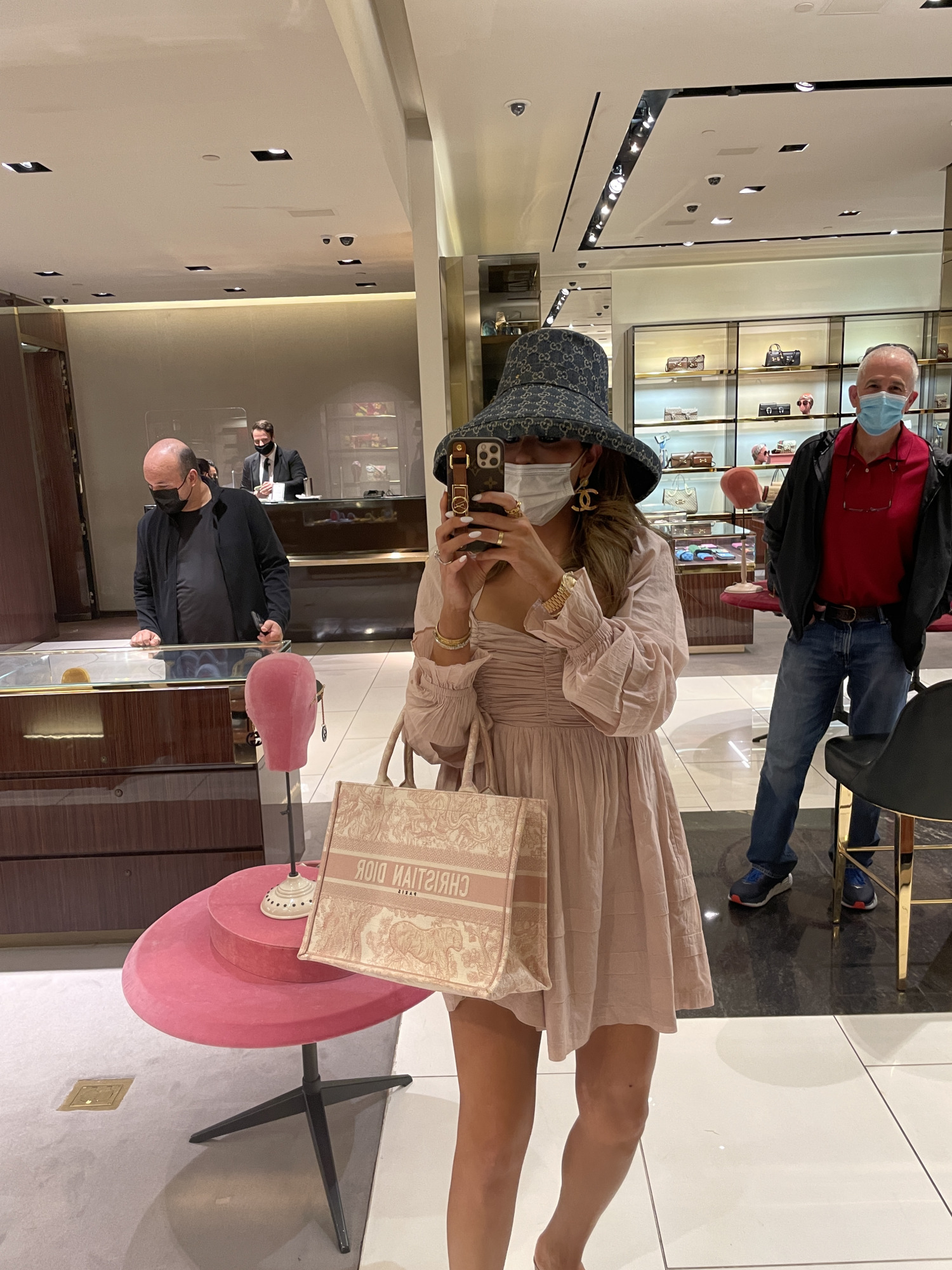 Instagram Recap by popular US life and style blog, The Sweetest Thing: image of Emily Gemma wearing a pink long sleeve mini dress, gold Chanel statement earrings, designer bucket hat, and holding a Christian Dior handbag.