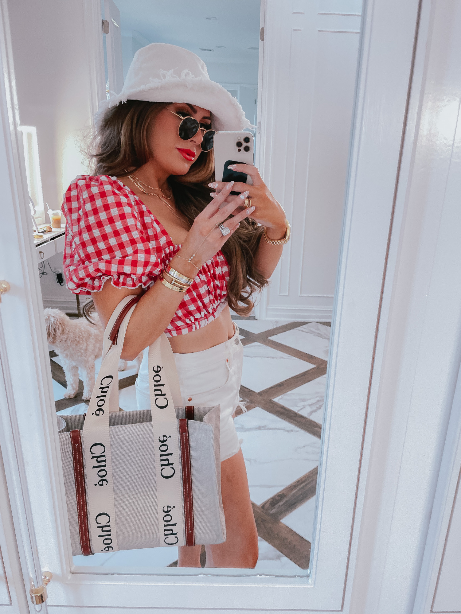 july 4 outfit inspiration 2021, pinterest july 4 outfit, bucket hat, gucci red lipstick, chloe tote bag, Emily gemma1 | June Instagram Recap by popular US fashion blog, The Sweetest Thing: image of Emily Gemma wearing a a white bucket hat, red and white gingham top, white shorts, sunglasses and holding a Chloe bag.