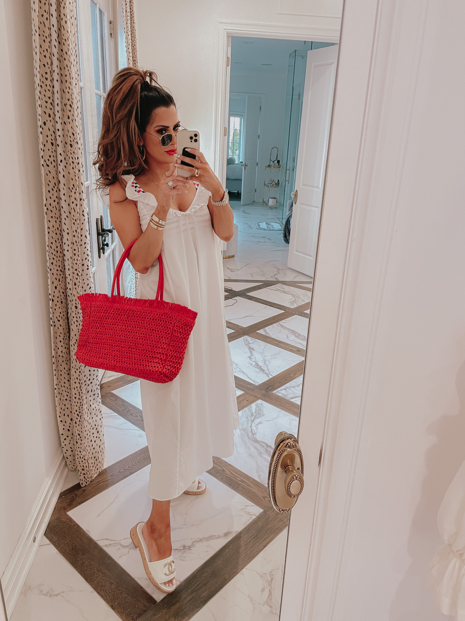july 4 outfit inspiration 2021, pinterest july 4 outfit, gucci red lipstick goldie red, Emily gemma | June Instagram Recap by popular US fashion blog, The Sweetest Thing: image of Emily Gemma wearing a white maxi coverup, white sandals, and holding a red woven tote bag.