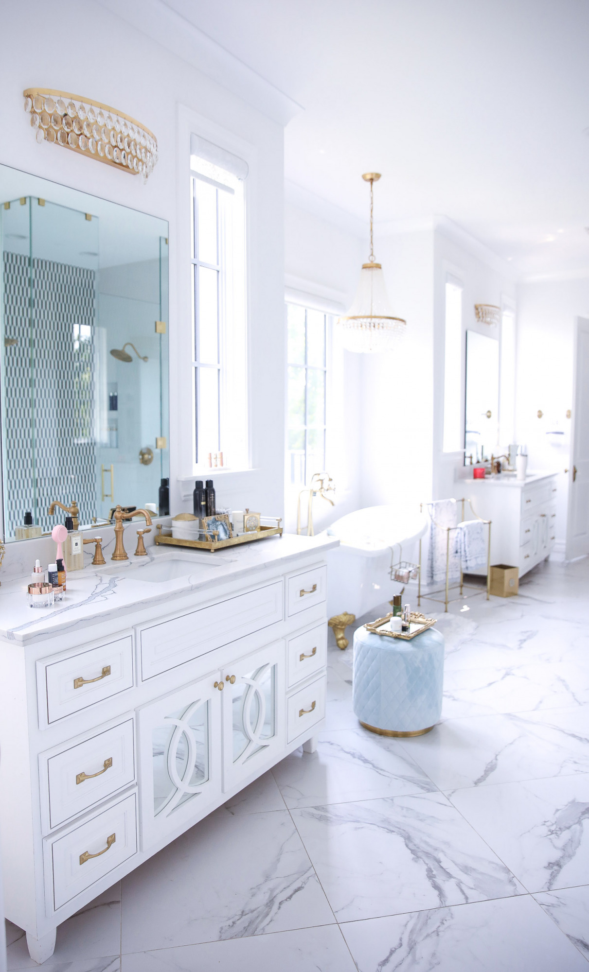 Delina Parfum de Marly set NSALE 2021, Emily gemma master bathroom, Nordstrom anniversary sale 2021 beauty must haves, anthropologie bathrom decor 2021, pinterest bathroom all white gold | Nordstrom Anniversary Sale 2021 by popular US life and style blog, The Sweetest Thing: image of a master bathroom with white marble flooring, white vanities, gold and crystal chandeliers and a white and gold clawfoot tub.