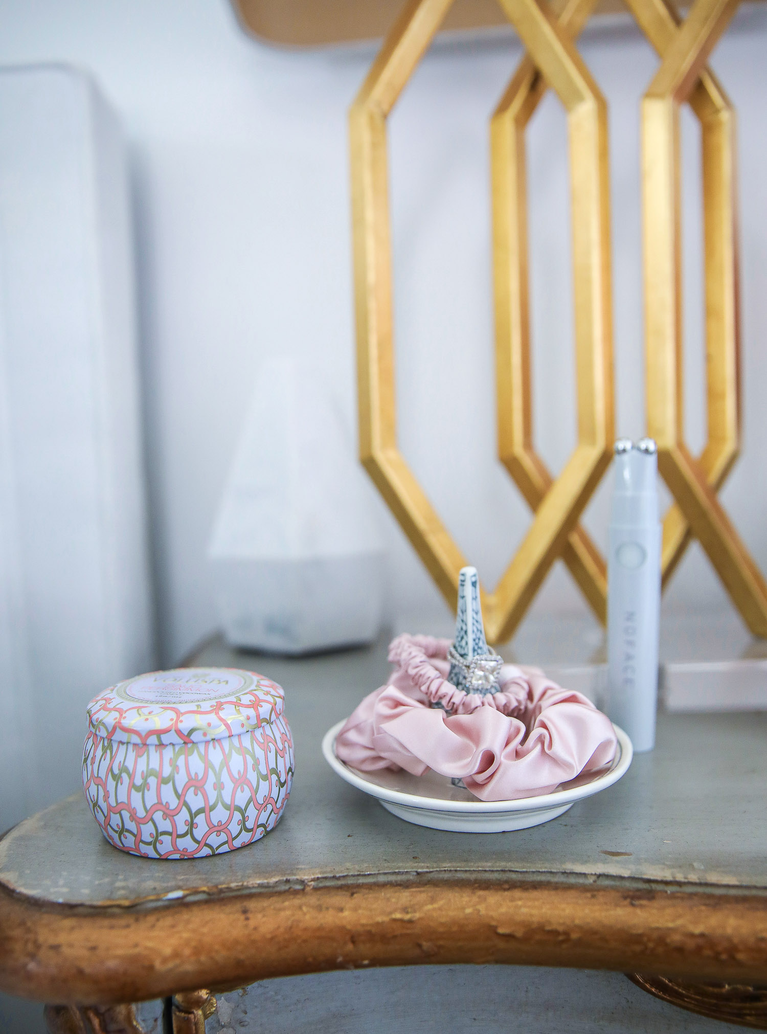 Nordstrom Anniversary Sale 2021 by popular US life and style blog, The Sweetest Thing: image of a master bedroom with a Voulspa candle and ring holder containing pink silk scrunchies and a diamond wedding band.