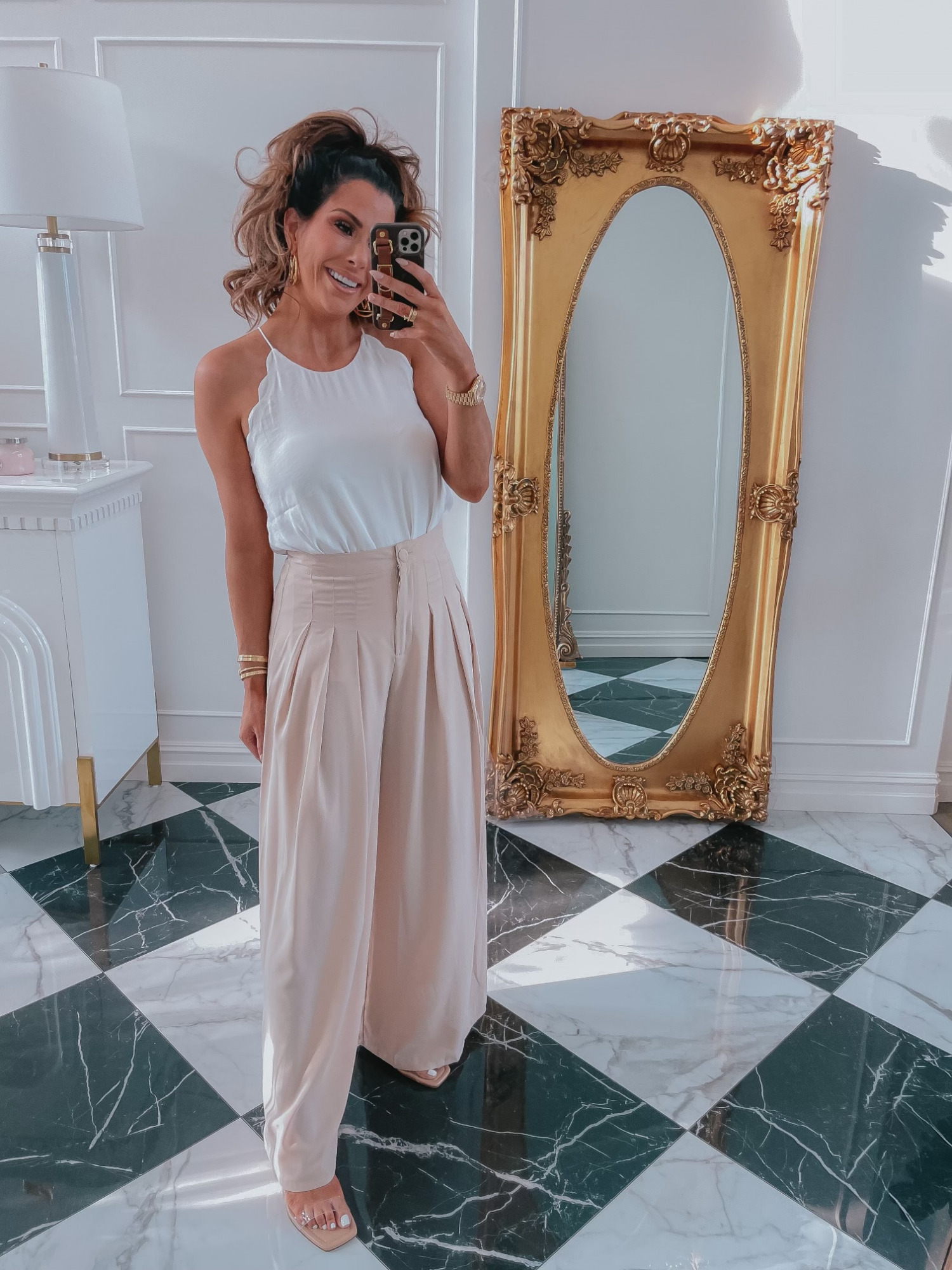 Red Dress Try On Haul, Lightweight summer pants, white scalloped top, easy to wear summer outfit ideas, casual summer outfit ideas, clear wedges, best wedges summer 2021 | June Instagram Recap by popular US fashion blog, The Sweetest Thing: image of Emily Gemma wearing a white scallop tank and tan high waist pleated wide leg pants.