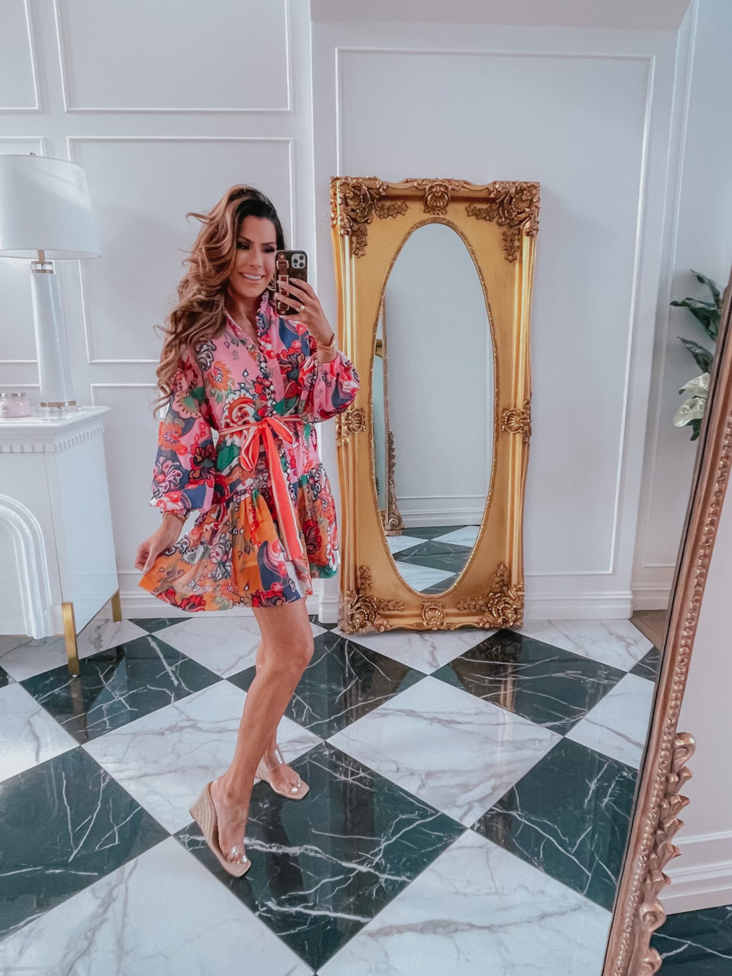 Red Dress Try On Haul, Emily Ann Gemma, Clear Wedges, Zimmermann dupe dress, colorful summer dress ideas, bright floral swing dress | June Instagram Recap by popular US fashion blog, The Sweetest Thing: image of Emily Gemma wearing a bright floral print dress and clear strap espadrilles.