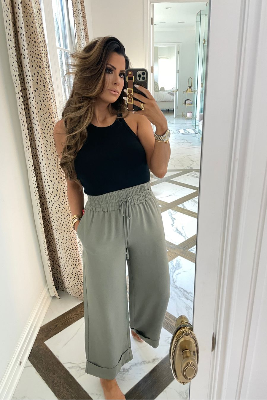 casual outfit ideas, best tank top summer 2021, tank tops under $30, best pants for warm weather, Emily ann gemma, casual outfit ideas summer 2021 | June Instagram Recap by popular US fashion blog, The Sweetest Thing: image of Emily Gemma wearing a black tank and grey wide leg drawstring pants.