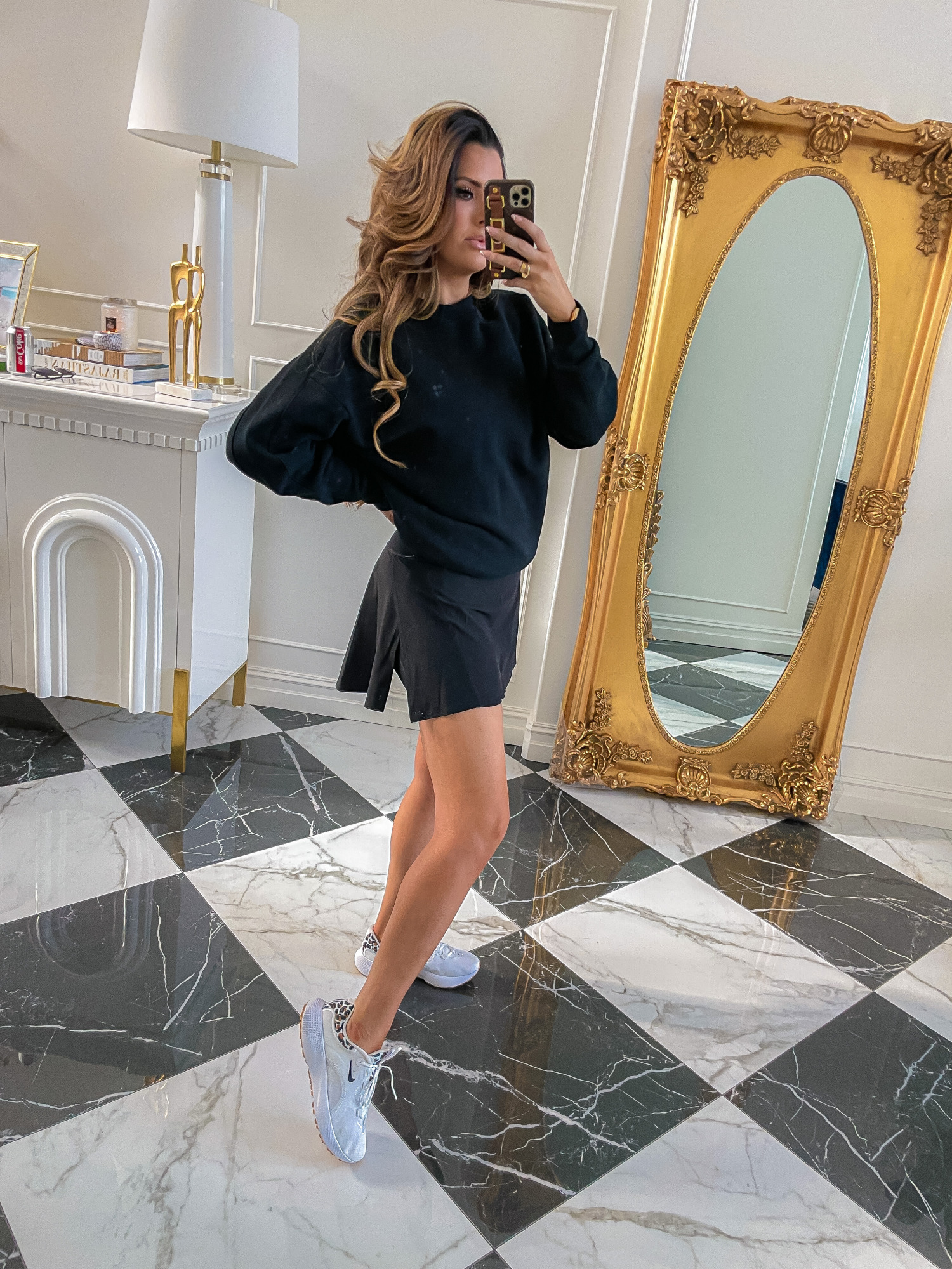 dstrom Anniversary Sale 2021 Picks, best of NSALE 2021, Nordstrom sale must haves blog post, Emily gemma9 |  Nordstrom Anniversary Sale US fashion blog, The Sweetest Thing: image of Emily Gemma wearing a Nordstrom black sweatshirt, black athletic skirt, and leopard print nike sneakers.