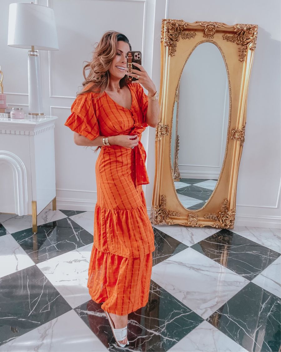 Red Dress Try On Haul, Best Summer Dresses 2021, white and gold summer slide sandals, affordable slide sandals, orange dress, summer date night dress, Emily ann gemma | June Instagram Recap by popular US fashion blog, The Sweetest Thing: image of Emily Gemma wearing an orange plaid maxi dress with white sandals.