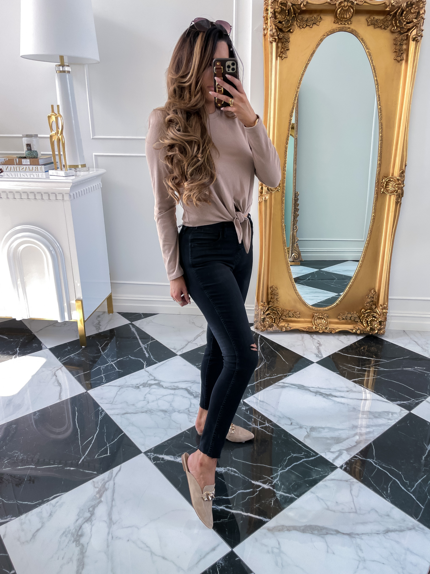 nordstrom sale 2021 must haves, Good american NSALE 2021, Emily gemma | Nordstrom Anniversary Sale by popular US fashion blog, The Sweetest Thing: image of Emily Gemma wearing a brown long sleeve tie front shirt, black leggings, and Steve Madden gold chain tan brown suede mules.