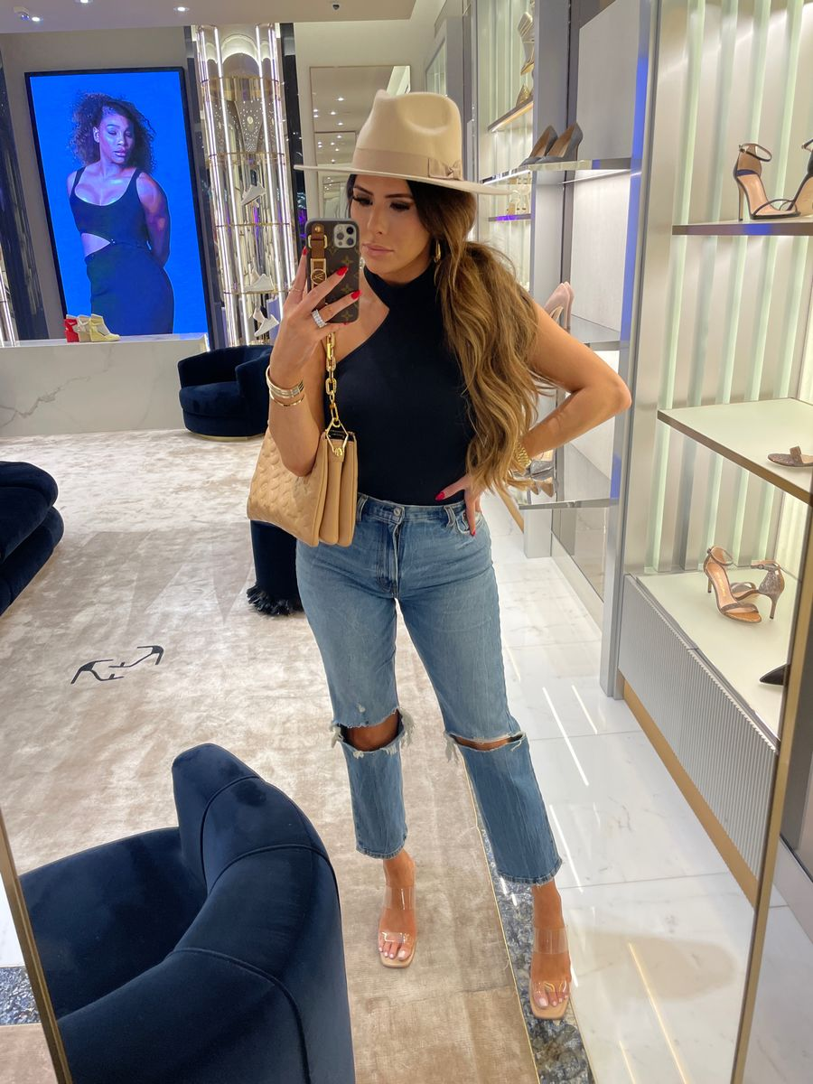 Emily ann gemma, shopping outfit, jeans, hat, black bodysuit, what to wear on a shopping trip, best handbags, fall hat    Instagram Recap by popular US life and style blog, The Sweetest Thing: image of Emily Gemma wearing a black mock neck tank, distressed jeans, clear strap sandals, tan felt rancher hat, and tan quilted purse.