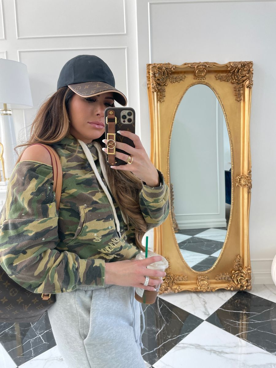 Emily Ann Gemma, Camo Sweatshirt, Sweatpants Outfit, Louis Vuitton Ballcap, Louis Vuitton Backpack    Instagram Recap by popular US life and style blog, The Sweetest Thing: image of Emily Gemma wearing a camo cold shoulder hoodie sweatshirt, black and brown Louis Vuitton baseball cap, and grey jogger sweatpants.
