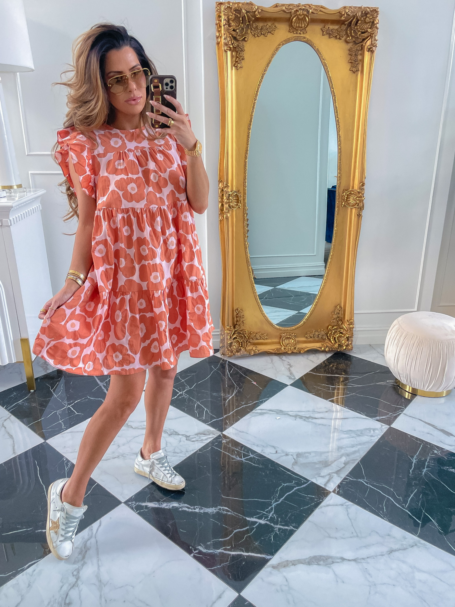 Red Dress Boutique, Red Dress Boutique, Summer Try On Haul, Summer Dress, Casual Summer Outfit Ideas, Golden Goose Sneakers, Louis Vuitton Sunglasses, Emily Ann Gemma   Instagram Recap by popular US life and style blog, The Sweetest Thing: image of Emily Gemma wearing a pink and orange floral print dress, oversized sunglasses, and Golden Goose sneakers.