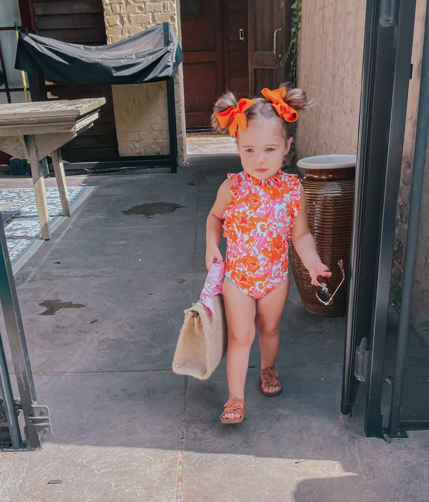 Sophia Gemma, Toddler Swimsuit, Toddler Bows, Swimwear for little girls, Kids Sunglasses, Baby Girl Summer Outfit Ideas   Instagram Recap by popular US life and style blog, The Sweetest Thing: image of Sophie wearing a Janie and Jack swimsuit, Zara sandals, orange hair bows and holding a woven handbag from Etsy.