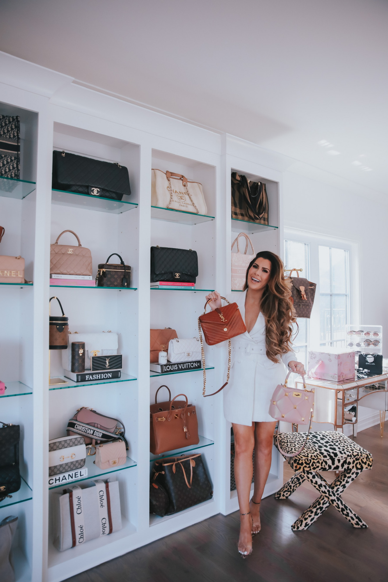 Emily Ann Gemma, Emily Gemma Closet, Emily Gemma Handbags, Two Story Closet, How to Display Handbags, Ebay Luxury Handbags, Pre-Loved Handbags, Chanel, Gucci, Valentino, Louis Vuitton   Instagram Recap by popular US life and style blog, The Sweetest Thing: image of Emily Gemma wearing a white misguided blazer dress and Giavanti Rossi heels while standing next to her designer bags.
