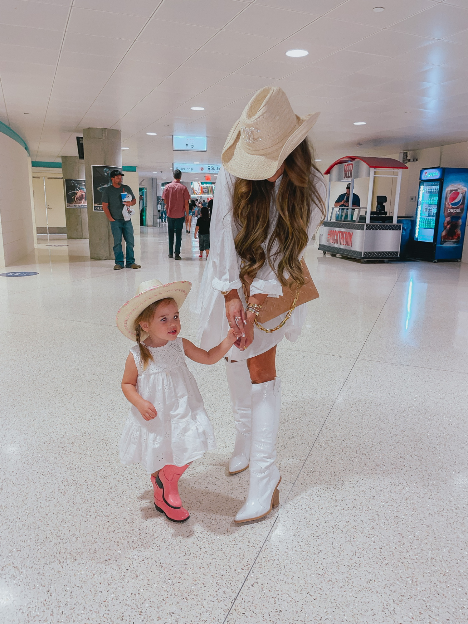Emily Ann Gemma, Sophia Gemma, Cowgirl Boots, What To Wear To The Rodeo, Western Outfit Ideas, Amazon Cowgirl Boots, Fendi Cowboy Boot Dupes, Louis Vuitton Handbag, Cowgirl Hat, Chanel Cowboy Hat   Instagram Recap by popular US life and style blog, The Sweetest Thing: image of Emily Gemma and her daughter wearing white dresses, tan straw cowboy hats, and cowboy boots.