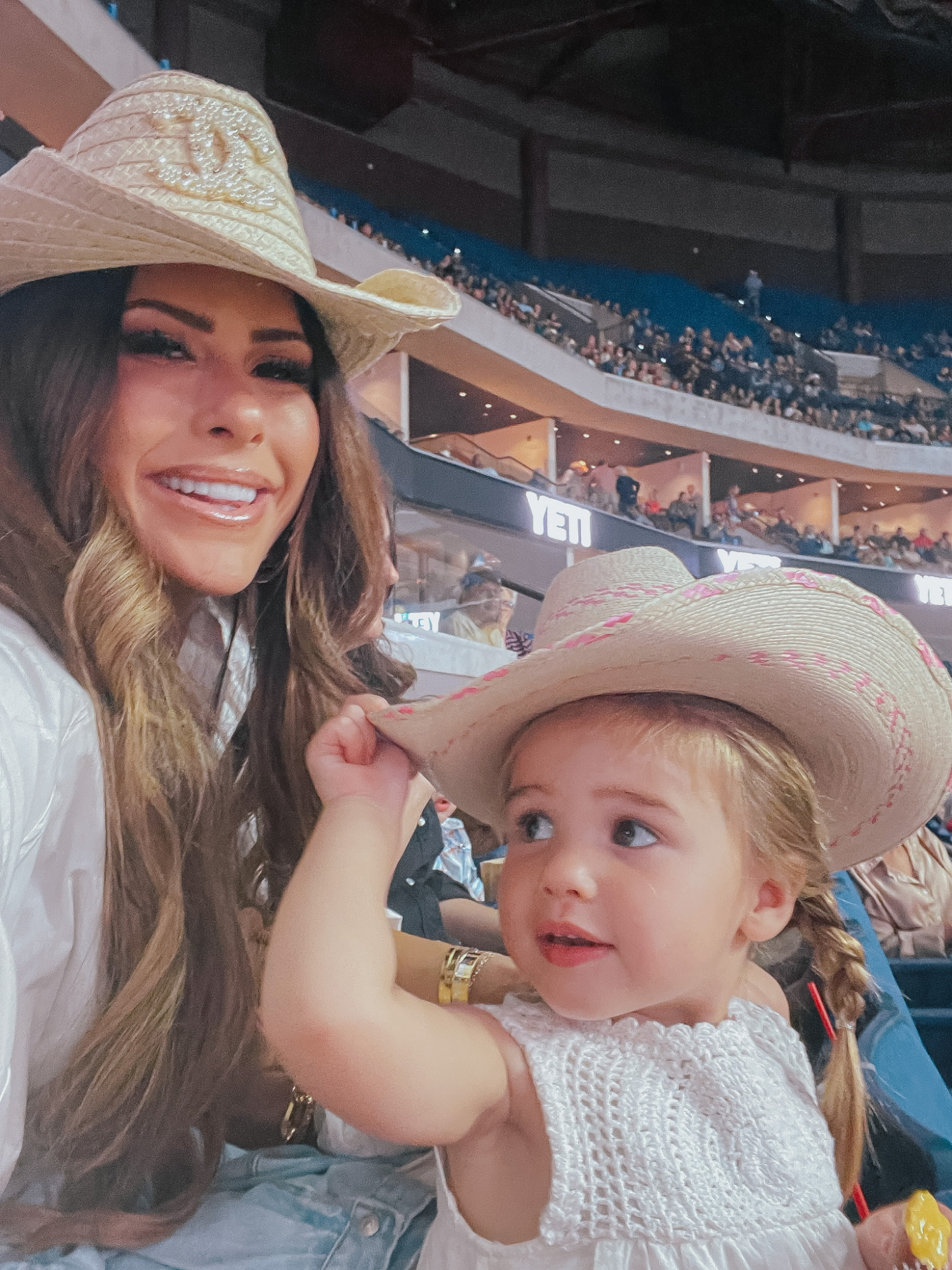 Emily Ann Gemma, Sophia Gemma, Cowgirl Boots, What To Wear To The Rodeo, Western Outfit Ideas, Amazon Cowgirl Boots, Fendi Cowboy Boot Dupes, Louis Vuitton Handbag, Cowgirl Hat, Chanel Cowboy Hat   Instagram Recap by popular US life and style blog, The Sweetest Thing: image of Emily Gemma and her daughter wearing white dress and tan straw cowboy hats.