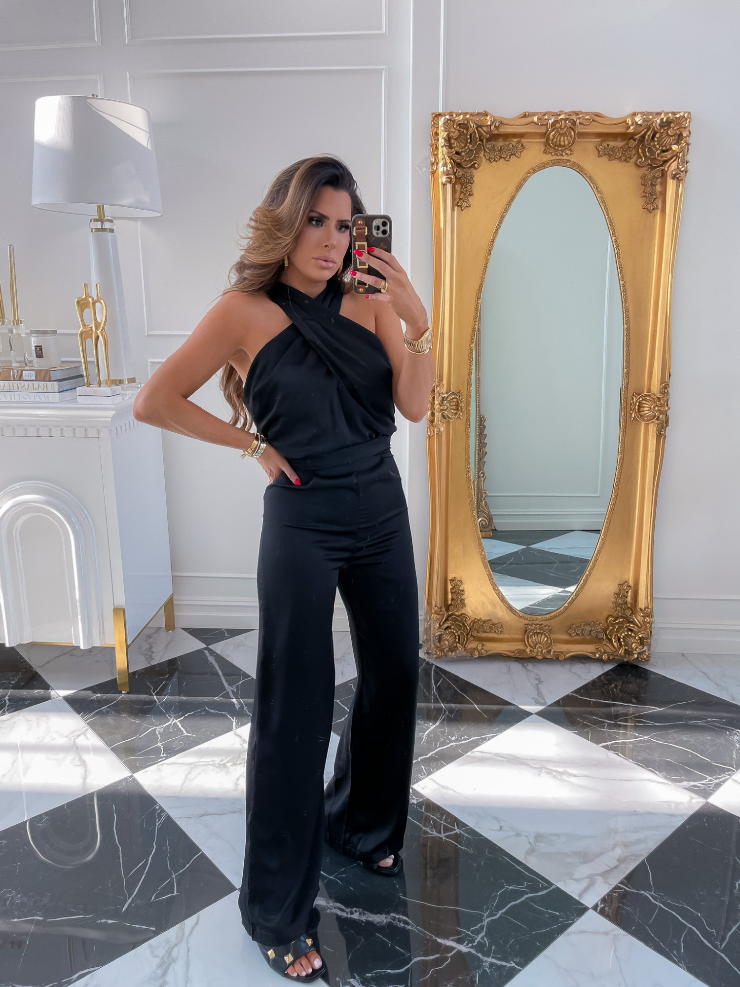 Red Dress Try On Haul, Fall Dresses, Fall Outfit Ideas, Wedding Guest Looks, Emily Ann Gemma, Pre-Fall Transitional Outfit Ideas | Fall Outfits by popular US fashion blog, The Sweetest Thing: image of Emily Gemma wearing a black Red Dress jumpsuit with black gold studded sandals.