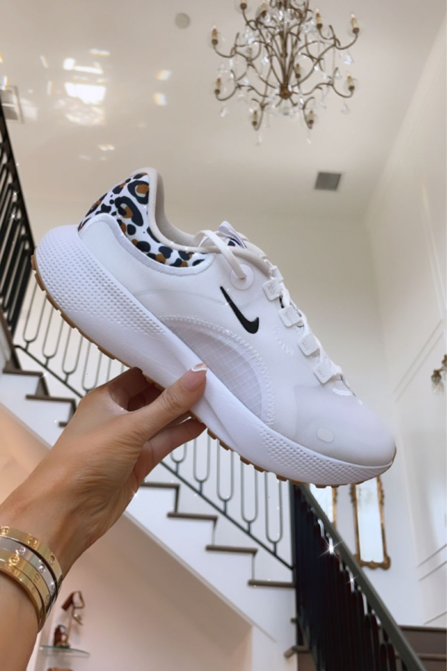 Nike Sneakers, Leopard Print Sneakers, White Sneakers, White Tennis Shoes, Nordstrom Sale Women's Shoes, Emily Ann Gemma   Instagram Recap by popular US life and style blog, The Sweetest Thing: image of Emily Gemma holding a white leopard print Nike sneaker.
