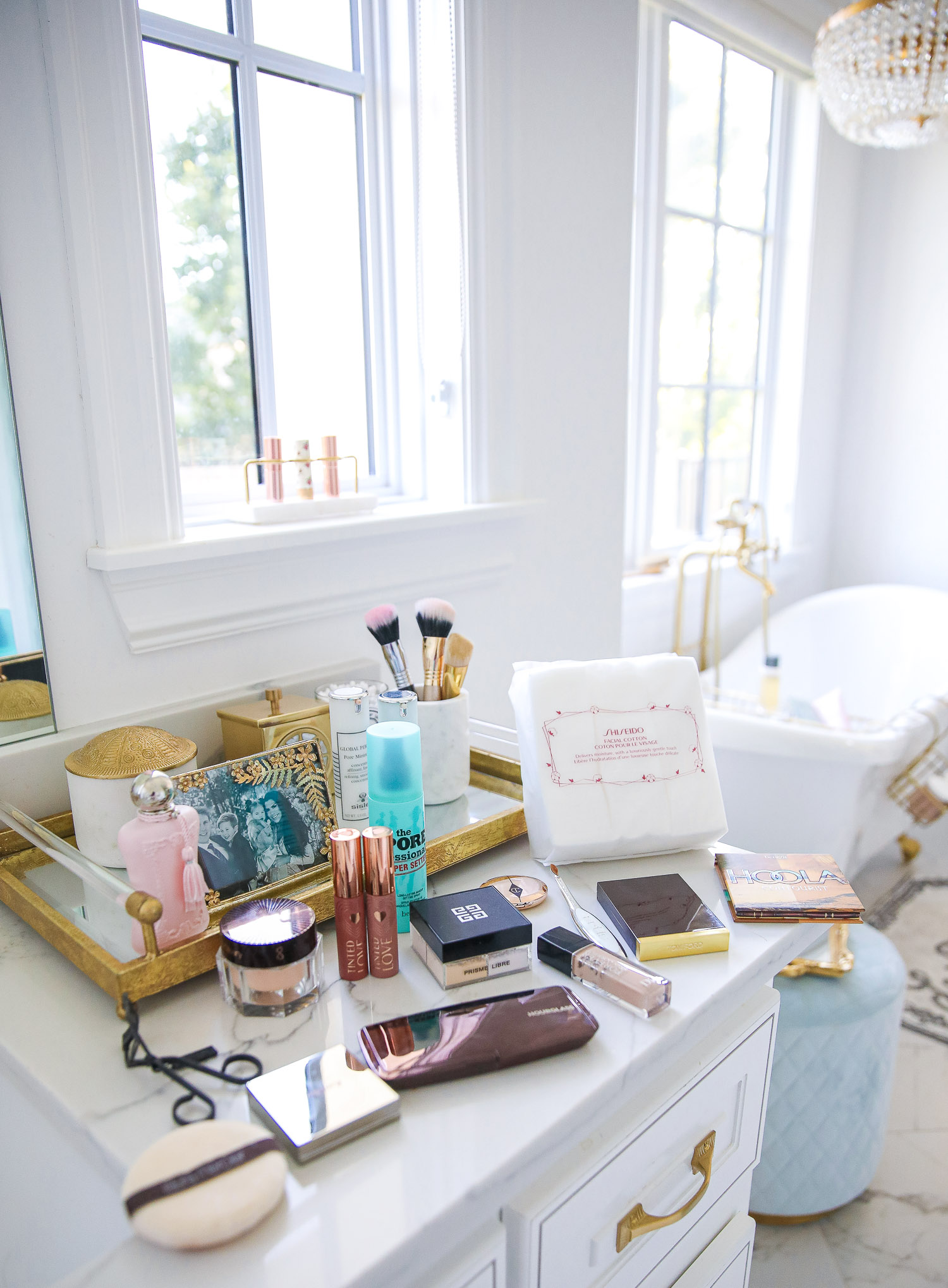 nordstrom beauty must haves fall 2021, sisley pore minimizer review, sisley blur powder review, sisley hyaluronic acid, emily gemma beauty must haves, hoola bronzer palette |  Beauty Favorites by popular US beauty blog, The Sweetest Thing: image of various makeup products spread across a white marble vanity top.