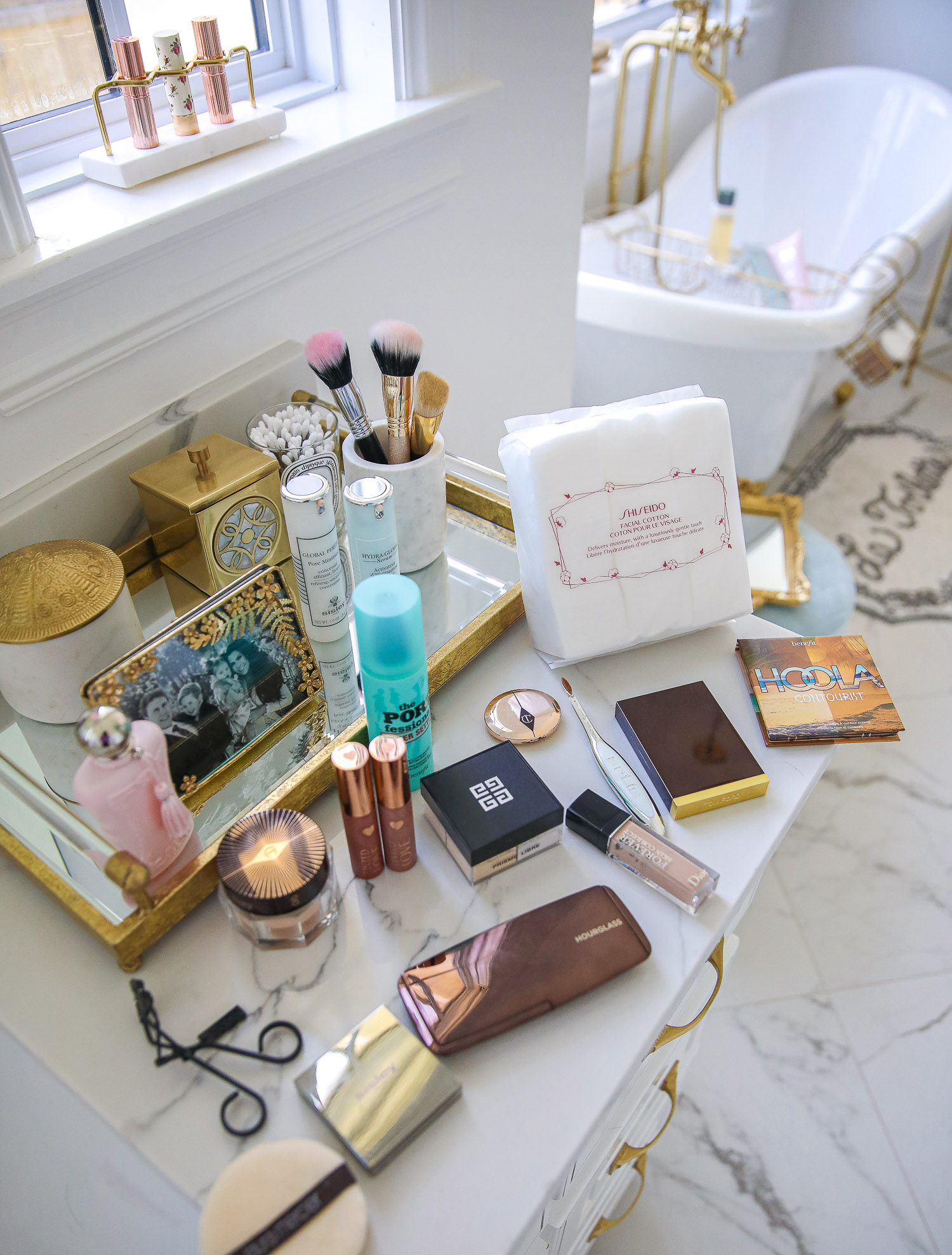nordstrom beauty must haves fall 2021, sisley pore minimizer review, sisley blur powder review, sisley hyaluronic acid, emily gemma beauty must haves, hoola bronzer palette |  Beauty Favorites by popular US beauty blog, The Sweetest Thing: image of various beauty products spread across a white marble vanity top.