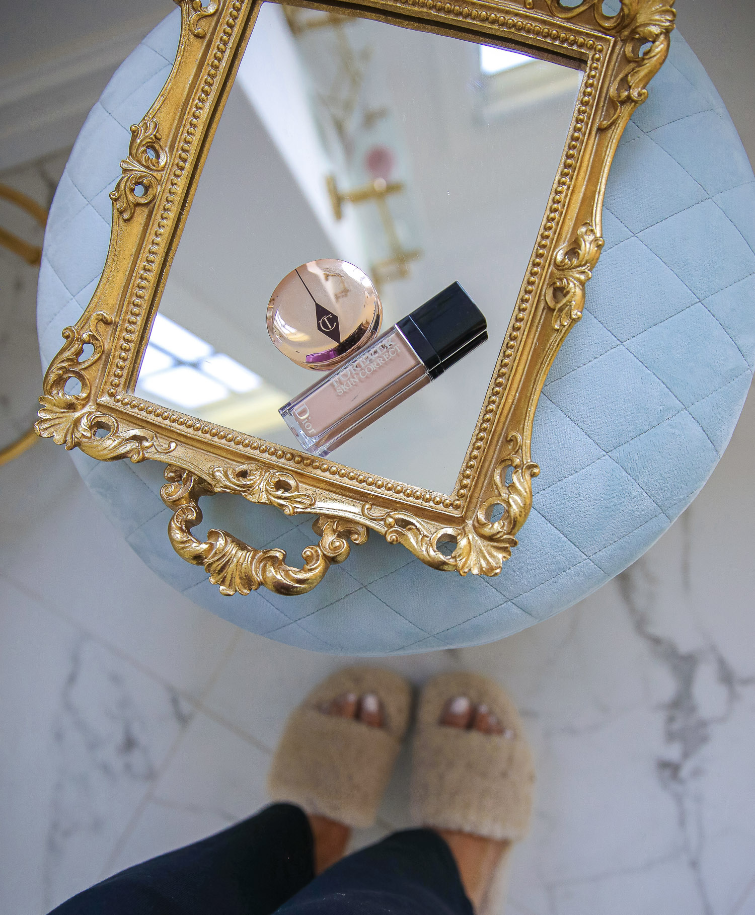 nordstrom beauty must haves fall 2021, sisley pore minimizer review, sisley blur powder review, sisley hyaluronic acid, emily gemma beauty must haves, hoola bronzer palette | Beauty Favorites by popular US beauty blog, The Sweetest Thing: image of a bottle of foundation and a bronzer compact on a mirrored gold frame tray.