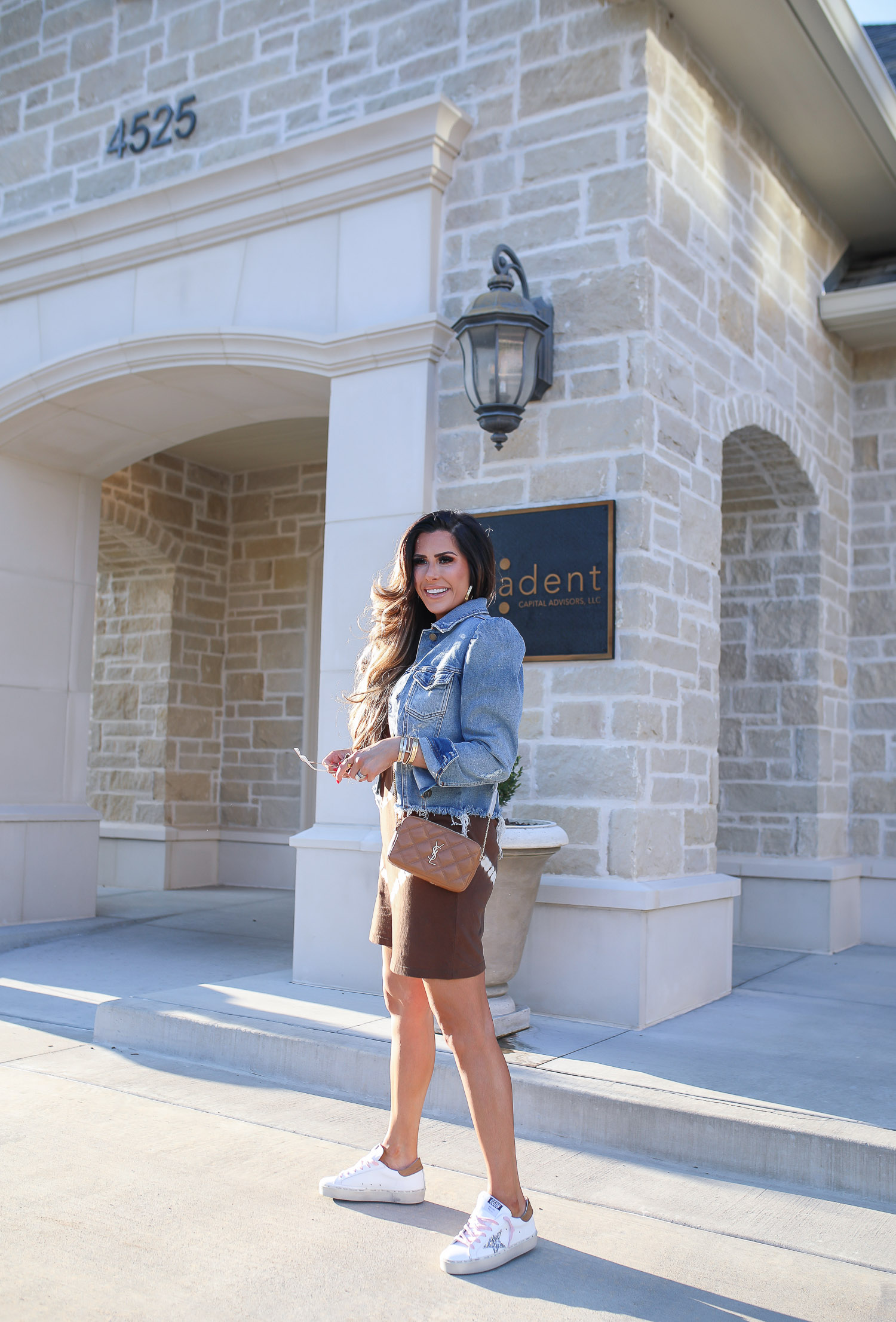 Fall Outfit by popular US fashion blog, The Sweetest Thing: image of Emily Gemma wearing. brown and white tie dye dress, white sneakers with pink laces, a denim jacket, and brown YSL crossbody bag.